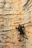 Business woman on rock wall Royalty Free Stock Photo