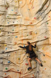 Business woman on rock wall Stock Photography