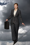 Business woman on rope. Stock Image