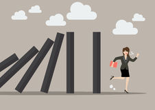 Business woman run away from domino effect Stock Image