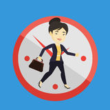 Business woman running on clock background. Stock Photo