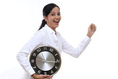Business woman running and holding a clock Stock Image