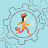 Business woman running inside the gear. Royalty Free Stock Image