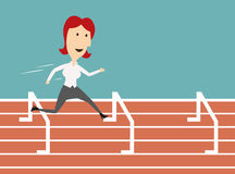 Business woman running and overcoming barriers Royalty Free Stock Photo