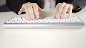 Business woman`s hand typing on keyboard computer in office close up.  stock footage