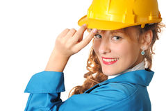 Business woman with safety hat. Business woman wearing yellow safety hat isolated on a white background Royalty Free Stock Image