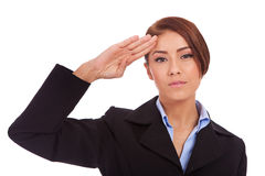 Business woman saluting Stock Photo