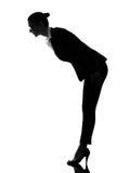 Business woman saluting bending silhouette Stock Photos