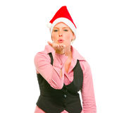 Business woman in Santa Hat blowing kiss Stock Photo