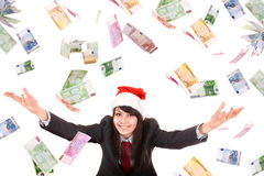 Business woman in santa hat with flying money. Stock Photos