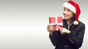Business woman in santa hat holding gift Stock Photography