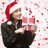 Business woman in santa hat holding gift Stock Image