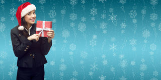 Business woman in santa hat holding gift Stock Photos