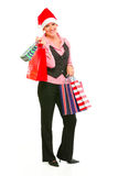 Business woman in Santa Hat holding shopping bags Stock Images