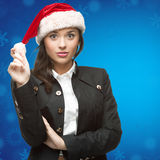 Business woman in santa hat Royalty Free Stock Photography
