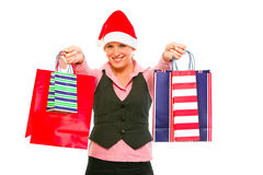 Business woman in Santa Hat with shopping bags Royalty Free Stock Photo