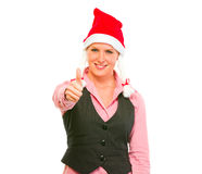 Business woman in Santa Hat showing thumbs up Stock Photo