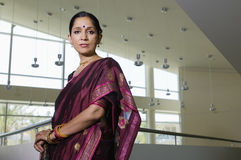 Business Woman In Sari. Portrait of a confident business women in sari at office royalty free stock images