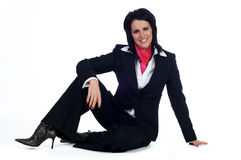 Business woman sat on the floor smiling Stock Photos