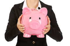 Business woman saving money in piggybank Royalty Free Stock Photos