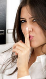 Business woman say shh secret. A beautiful brunette business woman saying shh it's a secret stock image