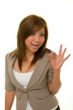 Business Woman Says A-Okay. Beautiful, young Asian woman in business suit expresses A-OK with her hand over accomplishment Royalty Free Stock Images