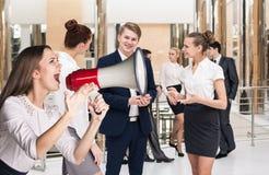 Business woman scream to megaphone Stock Photo
