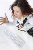Business Woman screaming angry. Business Woman screaming on the phone looking at her computer Stock Photography