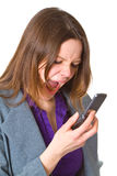 Business woman screaming in her cellphone Stock Image