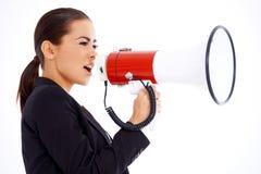 Business woman screaming loudly thru big megaphone Royalty Free Stock Photo