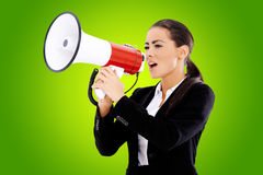 Business woman screaming loudly thru big megaphone Stock Photos