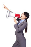 Business woman screaming with a megaphone. And finger point to empty copy space isolated on white background, model is a asian beauty Stock Photos