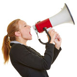 Business woman screaming in megaphone Stock Images