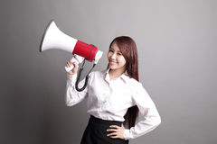 Business woman screaming with megaphone Royalty Free Stock Images