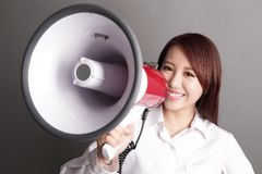 Business woman screaming with megaphone Stock Photos