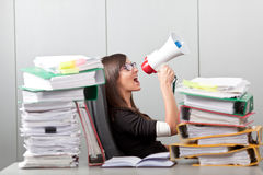 Business woman screaming with a megaphone Stock Photography