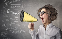 Business woman screaming with a megaphone Stock Photo