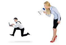 Business woman screaming on megaphone Stock Photo