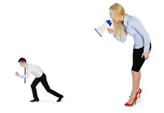 Business woman screaming on megaphone. Business women screaming on megaphone on little man Royalty Free Stock Photography