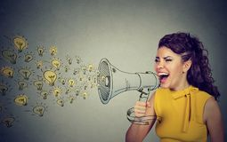 Business woman screaming out her ideas loud in megaphone Stock Images