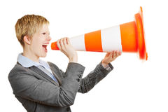 Business woman screaming in traffic cone Stock Image
