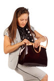 Business woman searches for something in bag Royalty Free Stock Photos