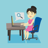 Business woman searching information on internet. Young asian business woman working on her laptop in office and searching information on internet. Concept of Royalty Free Stock Images