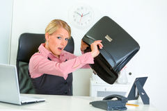 Business woman searching something in briefcase Royalty Free Stock Images