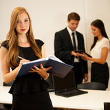 Business woman - secretarry  standing in first plain with cowork Stock Photos