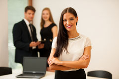 Business woman - secretarry  standing in first plain with cowork Stock Photo