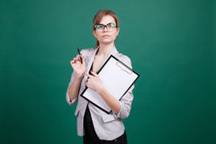 Business woman secretary stands with folder Stock Photo