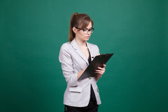 Business woman secretary stands with folder Royalty Free Stock Photos