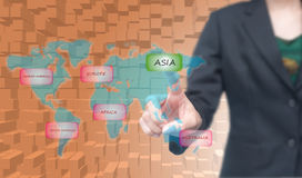 Business woman select Asia icon on worldmap Royalty Free Stock Images