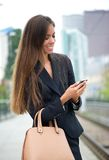Business woman sending message on phone Royalty Free Stock Images